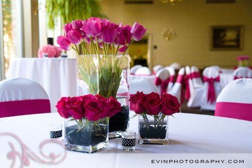 We incorporated beautiful fuchsia florals containing hot lady roses tulips